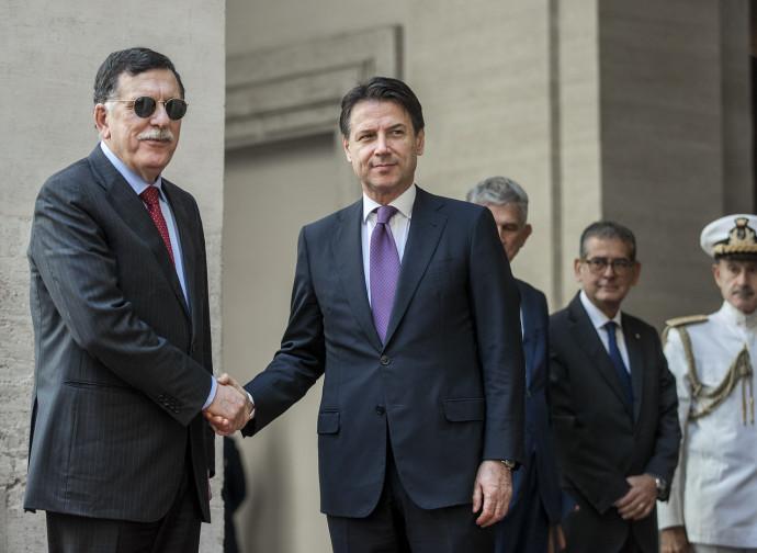 Al Sarraj e Conte in tempi migliori