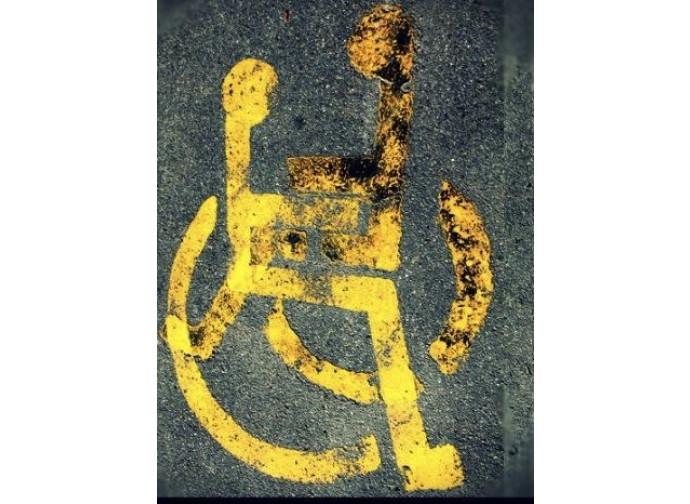 Il simbolo dell'assistente sessuale per i disabili