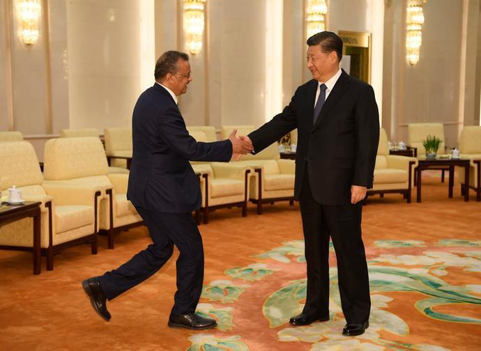 Il direttore generale dell'OMS con Xi Jinping