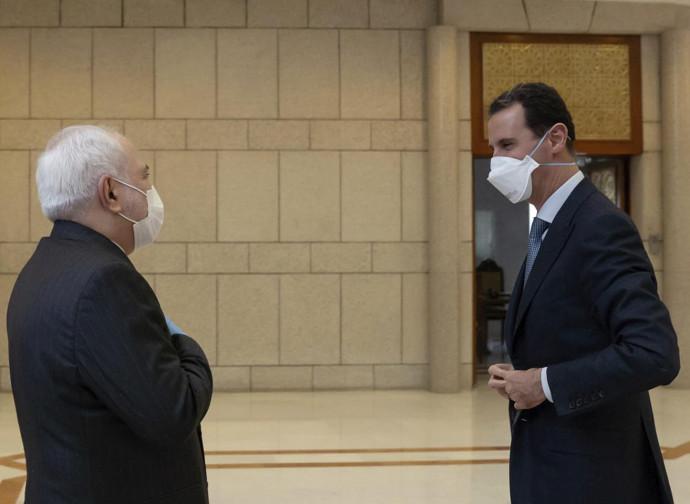 Zarif (Iran) e Bashar al Assad
